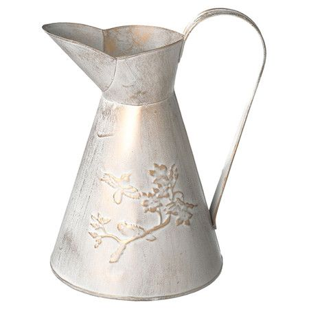Jocelyn Antiqued pitcher with bird and branch embossed details.    Product: Pitcher Construction Material: MetalCo...