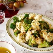 Citrus and green olives garnish this simple roasted cauliflower and broccoli side dish, a must-have on the holiday dinner table.