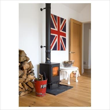images of rooms with modern wood stoves | GAP Interiors - Wood burning stove in modern living room - Picture ...