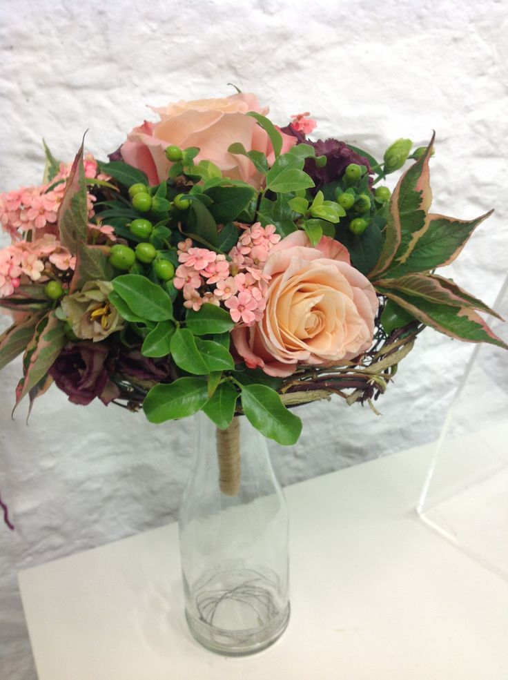 This lovely posy bouquet in an ivy frame was created by Brenda Duval. www.academyoffloralart.com