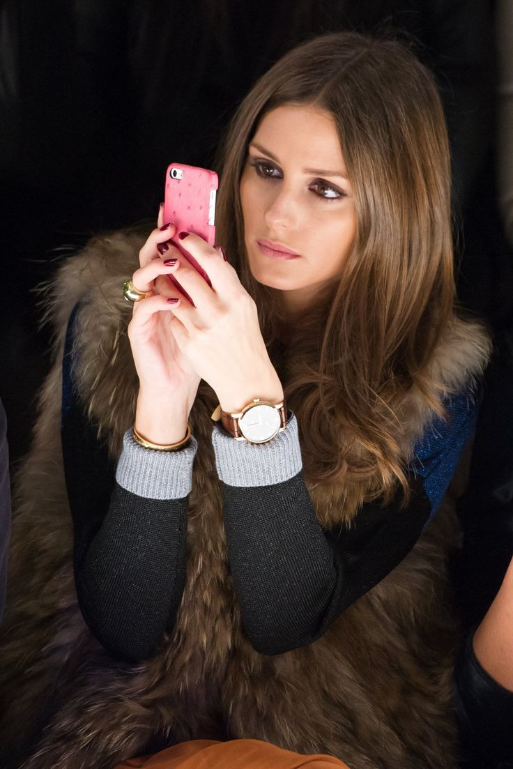 Olivia Palermo taking photos at #NYFW.  Glad those sleeves are rolled up so we can see that #armcandy