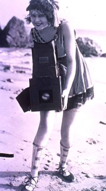taking pictures on the beach, 1920s