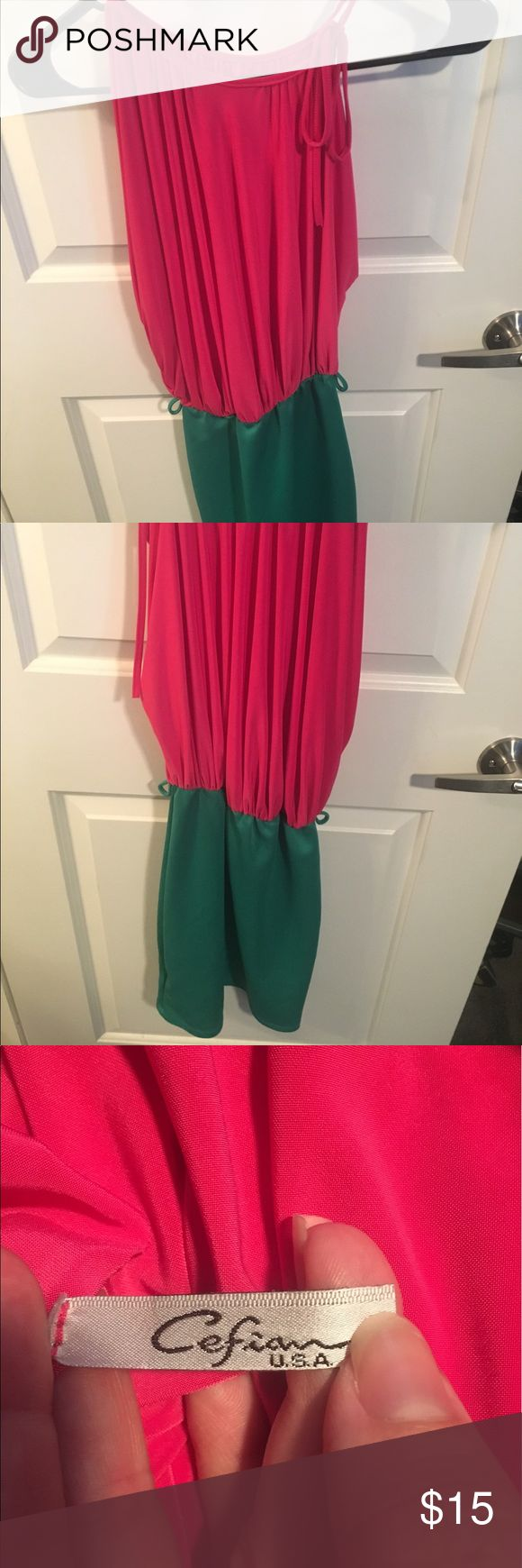 Pink and green dress Pink and green mini dress, only worn a few times. There are loop holes for a belt even though one was not included. Dress is very stretchy and flattering, one shoulder is able to be adjusted for different sizing. Message me regarding alternative payment, packages and trades Dresses Asymmetrical