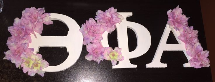 Greek letters! Wooden letters painted a cream color with pink flowers!
