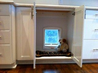 Cute dog door hidden in kitchen cabinet