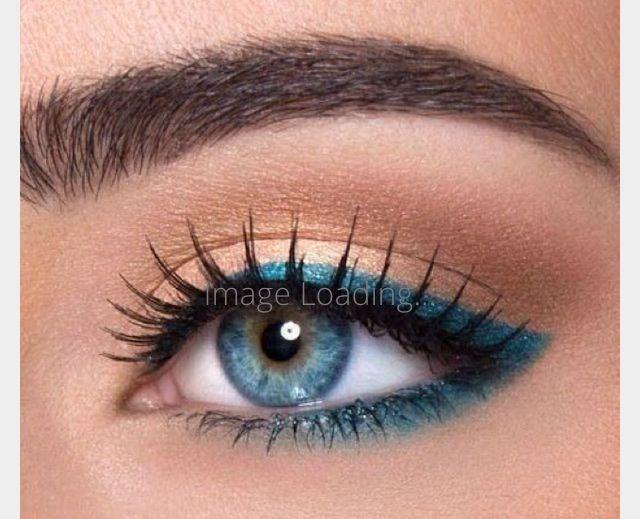 Blue eyeliner around eye. Simple and stunning