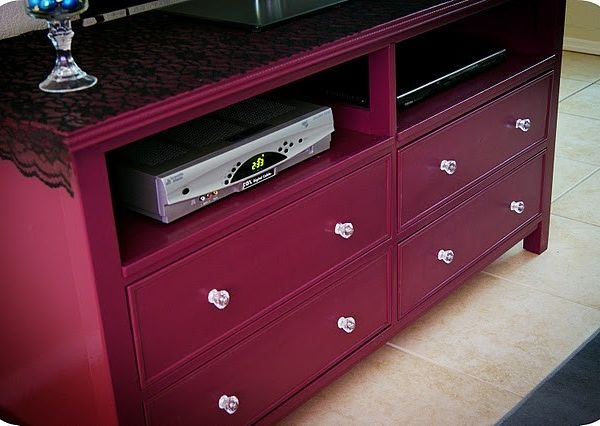 Remove top drawers (and rails) from dresser. I might have to remove the middle drawers too... Drill holes in back for cords and use as an entertainment center.