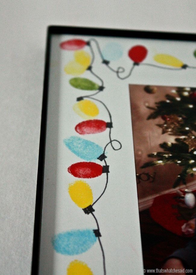 Make a keepsake frame using thumbprints as a string of Christmas Lights!  Perfect for Grandparent Gifts!