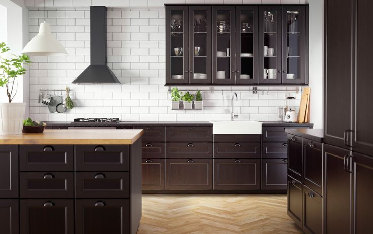 Traditional dark kitchen with solid wood and black worktops plus traditional style appliances - add white open shelves instead of tall dark uppers, and I love it!