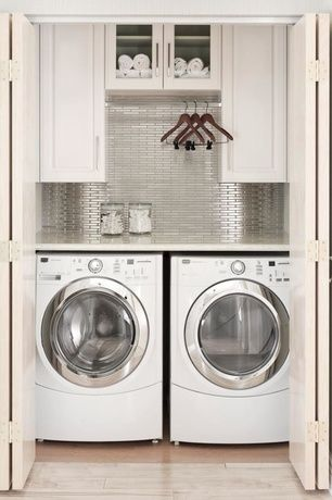 www.stainlesssteeltile.com likes the fresh, modern idea laundry room design- stainless steel wall