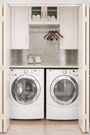 www.stainlesssteeltile.com likes the fresh, modern idea laundry room design- stainless steel wall