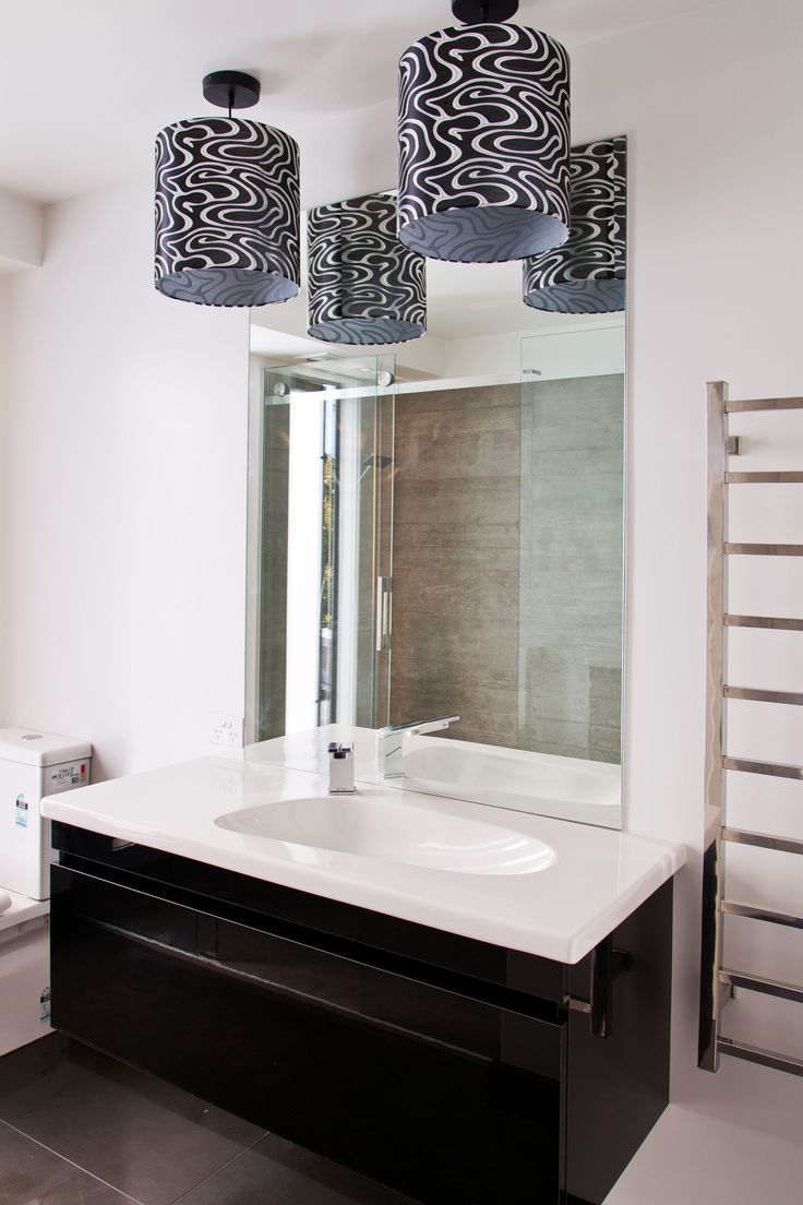 The main bathroom also has twin light shades above the vanity