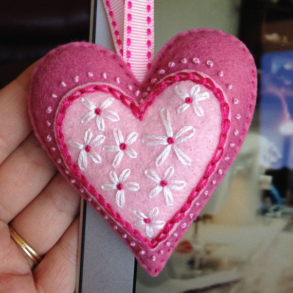 Heart Ornament made from rose pink, light pink and hot pink felt. Hand cut hearts embellished with lots of hand stitching in white, pink and hot pink