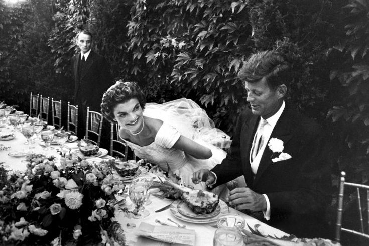 senator john kennedy and his bride, jacqueline bouvier kennedy, smile during their wedding reception. september 12, 1953, in newport, rhode island.