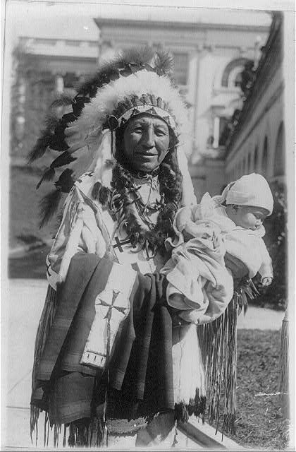 Chief Spotted Crow of the Sioux tribe of Pine Ridge, S.D. and his five months old granddaughter,   Lena Lou White House, who was named by Vice President Curtis a few days before, 1929