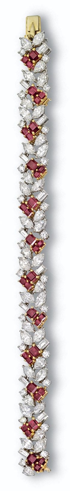 RUBY AND DIAMOND BRACELET, CARTIER. The stylized foliate motif set with 12 pear-shaped, 24 marquise-shaped, 24 round and 12 baguette diamonds weighing a total of approximately 16.20 carats, further accented with 36 square-cut rubies, mounted in platinum and gold, length 7 inches, signed Cartier, numbered 301.