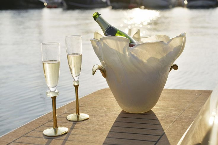 Discover this blue dinner set, inspired by endless love! It's a magical blue table setting accompanied by blue platters. It's unique designer tableware, a blue dinner set to sail away – magic in the making! Lovely glass champagne flutes with complimentary champagne ice bucket to celebrate with style.