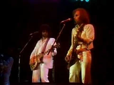 E.L.O. .....Sweet talking woman. i love ELO. Makes me feel all warm and fuzzy and reminds me of childhood..
