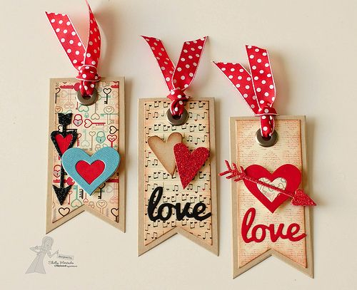 handmade Valentine tags ... kraft base ... patterned paper ... die cuts of hearts and LOVE ... big grommet ... red ribbon with white polka dots  .... sweet !!