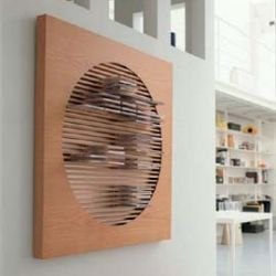 This wood CD wall rack by Porada serves as wall art as well as a functional way to store your cds! Designed by M. Marconato & T. Zappa