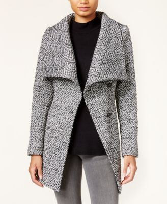 An asymmetrical design creates haute angles for Jessica Simpson's structured, wrap-style coat. | Shell (tweed): polyester/rayon/acrylic/nylon/cotton/wool; shell (gray) polyester/acrylic/wool; shell (p