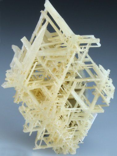 A beautiful specimen of Cerussite with diamond like shape depicting the classic reticulated crystal habit, from a New find from the Nakhlak Mine, Iran made this year (2013). The Cerussite specimen shows a criss-cross network of intergrown crystals, with bright creamy translucent crystal growth. The specimen can be viewed from both sides to see the reticulated crystal habit, an excellent Cerussite from the mine.
