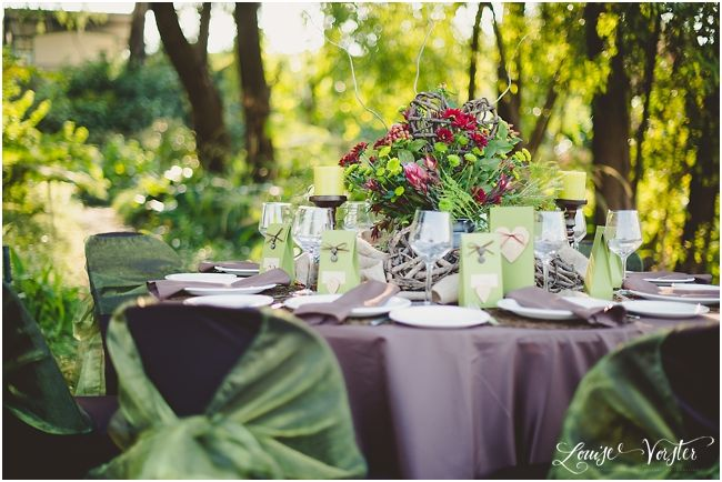 Another view of the green brown table. You can see the brown chair covers with the green organza chair ties. This shows the overall table in its surroundings.