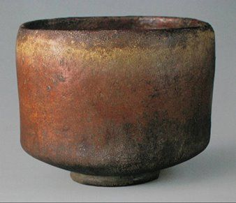 A traditional hand-built Raku tea bowl or chawan in Japanese.