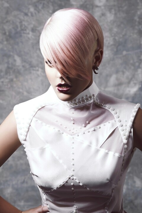 X-FILES  (Total Lunar)  Inspired by #Lunar and #Solar #Eclipses this look gives a futuristic feel flowing from the hottest catwalk trends.  With #Kate #Kondas's #undercut a huge inspiration after walking first for Jon Galliano  Aggression shows feminity in this look pairing the undercut with soft textures through the fringe and back tail areas, with strong lunar shaped lines through the sides of the head.  A hot trend in the upcoming seasons. #Iwantthathair www.houseofernest.com.au