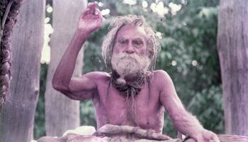 Devraha Baba was a siddha who lived for over 250 years, before entering samadhi in 1989. So elderly was he that the first President of India, Dr. Rajendra Prasad, more than fifty years ago, said that his father had sat at the feet of Devraha Baba as a child – that is, in the middle of the nineteenth century – and Devraha Baba was already elderly at that time. Devraha Baba never took food, and never set foot on the ground. He lived in a unique hut that was raised off the ground by bamboo…