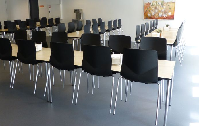 Varde City Hall - Four Design - in the city hall canteen, which can take seat 150 persons, are Four Eating tables and Four Sure 44 chairs in black with chrome frame.