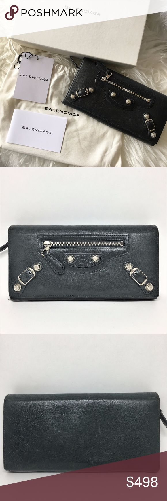 """BALENCIAGA Giant City Wallet Pre-owned Approx size: H: 4"""", L: 7.5"""". D: 1"""" Color: Looks black but it's dark green (olive) with silver hardware Closure: snap 13 credit card slots, 4 compartments, 1 zip pocket with 2 compartments inside, small pocket exterior Includes care card, tag, dust bag and original box Condition: BBB (refer to last picture for definition) In very good condition. No scuffing on the leaher. Some scratches on the leather on the exterior back side. (refer to pictures)…"""