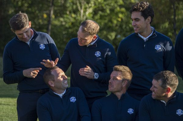 Henrik Stenson of Sweden (3rd R), Lee Westwood of Great Britain (R) and Rafa Cabrera Bello of Spain (2nd R) look on as Danny Willett of Great Britain (C) and European team Vice-Captain Padraig Harrington of Ireland (L) tease Sergio Garcia of Spain (2nd L) about his hair during team photos at Hazeltine National Golf Course in Chaska, Minnesota, September 27, 2016, ahead of the 41st Ryder Cup.  / AFP / JIM WATSON