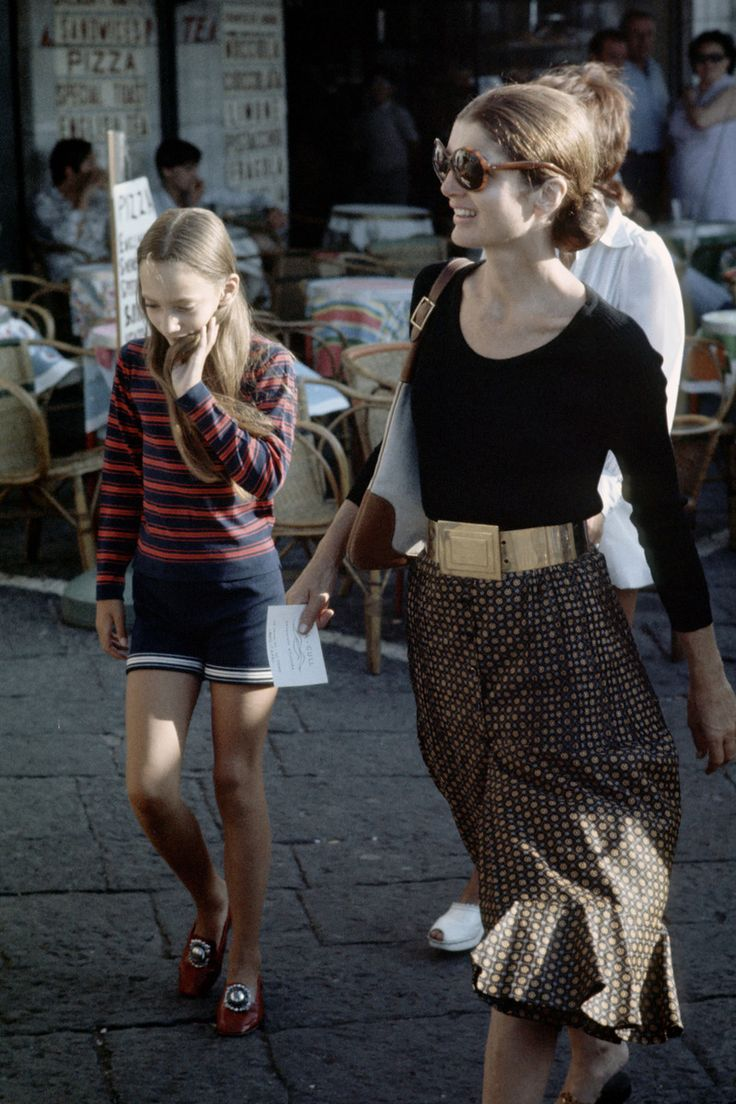 August 24, 1970.  Jackie Kennedy with Tina Radziwill shopping in Capri, Italy.