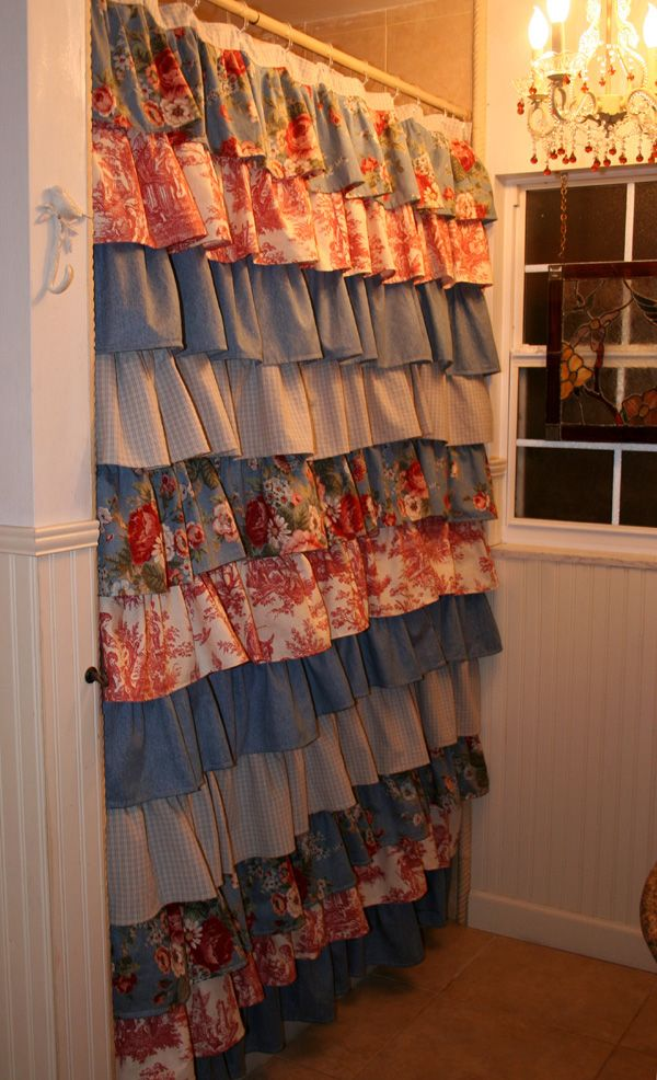 Ruffled Shower curtain made with layers of drapery fabric. A lovely combination of denim blue, with beautiful English roses and French Toile fabric is in one of the guesthouses