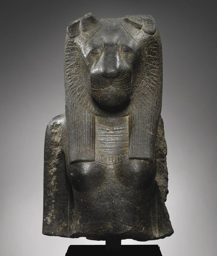Egyptian Granite Bust from an Enthroned Figure of the Goddess Sekhmet, 18th Dynasty, reign of Amenhotep III, 1403-1365 B.C.  Height 27 1/8 in. 69 cm.