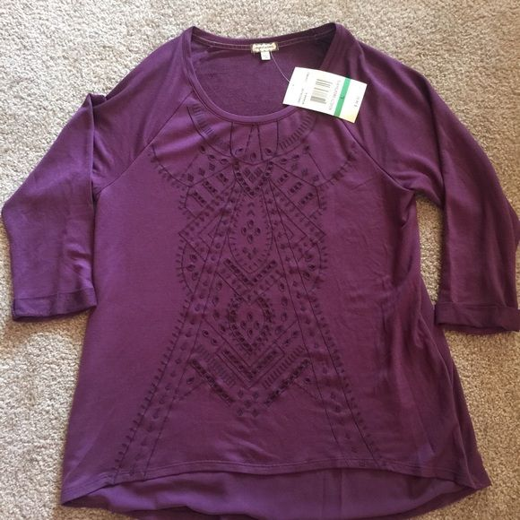 NWT 3/4 sleeve top Beautiful top with 3/4 sleeves and silky liner at bottom hem. Fits loosely so would fit medium or large! NWT in perfect condition! Tops