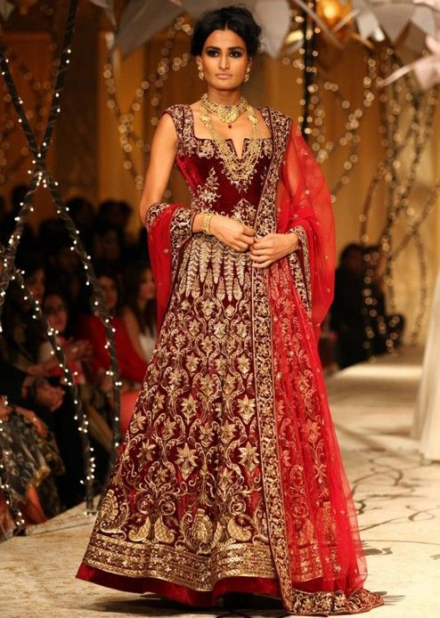 Model walks the ramp in maroon embellished lehenga for Rohit Bal at Indian Bridal Week 2013