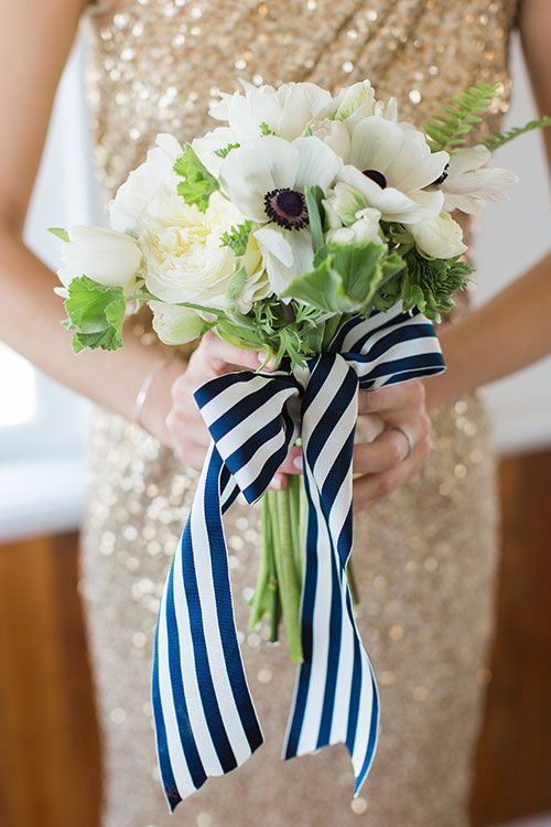 An anenome bridesmaid bouquet tied with striped ribbon | @lauren_fair | Brides.com