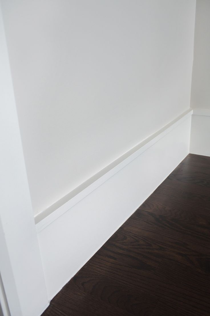 Wood baseboard in bathroom - Clean Modern Baseboard Idea