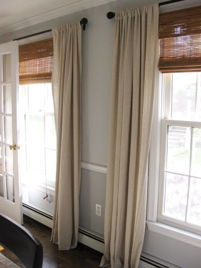 natural look window treatments: use drop cloth fabric, matchstick blinds, matte-black curtain rod hung high