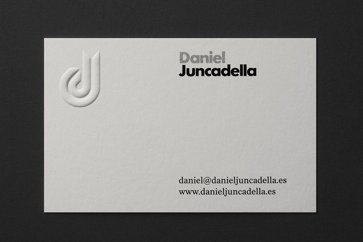 White blind embossed business card design with silver ink detail by Mucho for racing driver Daniel Juncadella