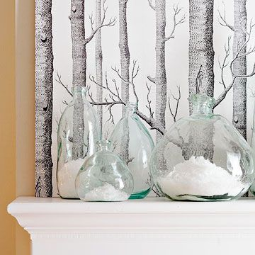 Frozen in Time  Fill a clear glass jar with artificial snow and place in front of an oversize winter photograph.