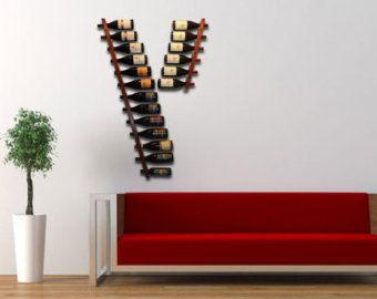 Nuestro moderno del colgante de pared vino bastidores handcrafted de la madera dura reclamada de Jarrah en Missoula, Montana. Se tiene mucho cuidado en cada detalle para proporcionar una muestra verdaderamente premium para tus vinos favoritos. Estos botelleros son ideales para espacios grandes y pequeños y funcionan especialmente bien cuando se usan múltiples parrillas. Colores y tamaños de encargo se pueden solicitar con el botón Solicitar una orden de encargo. Dado que estos estantes son…