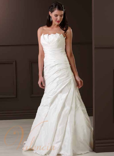 Valencia Bridal v202  Structured, fitted gown with long sweeping train. Zip back