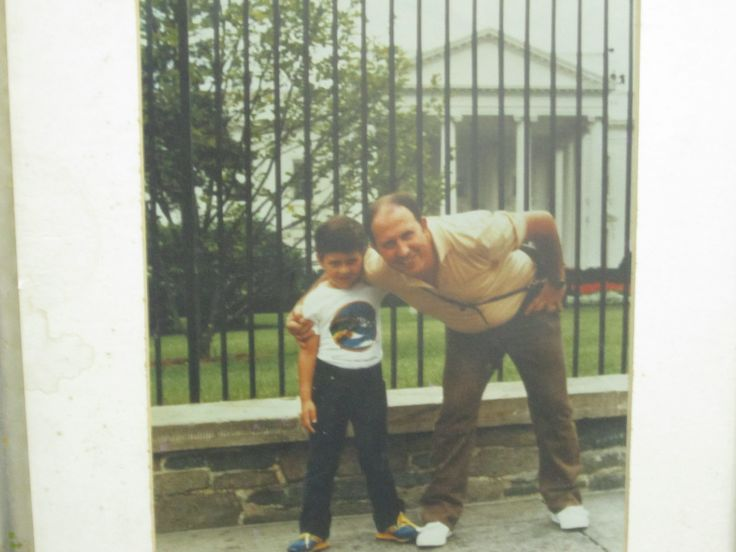 Pablo Escobar with one of his children posing in front of the White House in Washington D.C.