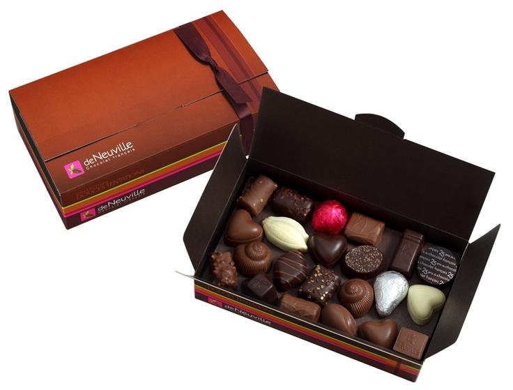 Ballotin 47 chocolats  Véritable palette de saveurs : chocolat noir, lait ou blanc - ganaches, pralinés, pâtes damandes, nougatines, liqueurs, ... Toute la force et la douceur de grands chocolats De Neuville pour succomber à la tentation.