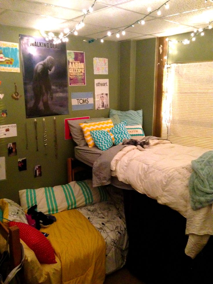 Layered bunk beds, L-shape with hanging lights and decorative pillows. Very lofty Dorm Room ...