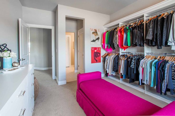 A extra spare bedroom in your home can be transformed into a beautiful dressing room, like this white melamine walk-in closet.  Learn more here: https://www.closetfactory.com/custom-closets/