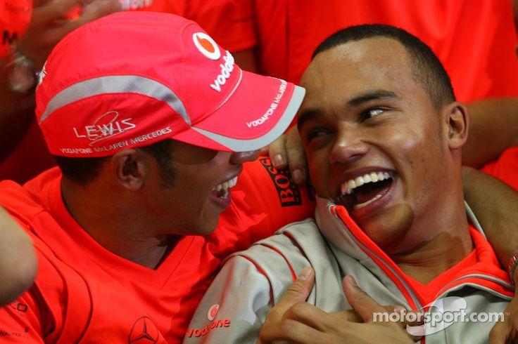 2008 Formula 1 World Champion Lewis Hamilton celebrates with his brother Nicolas